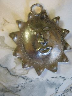 Metal Sun Pendant by janissupplies on Etsy, $12.50