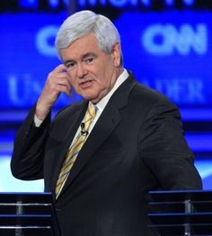 Former House Speaker Newt Gingrich is seen during a break in the first New Hampshire Republican presidential debate at St. Anselm College