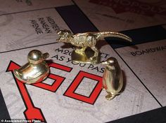 This  photo shows the three new tokens in Atlantic City, N.J., that fans from around the world have voted into upcoming editions of the board game Monopoly: a duck, a T-Rex dinosaur and a penguin. Hasbro Inc. revealed the results of voting on Friday