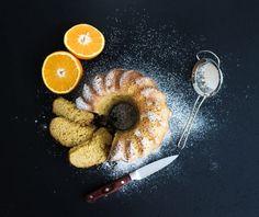 Moist orange bundt yoghurt cake with sugar powder, dark grunge background. Orange Plates, Icing Ingredients, Yogurt Cake, Jus D'orange, Food Categories, Biscuit Recipe, Food To Make, Lime, Cooking Recipes