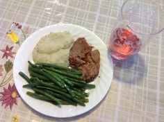 Garlic pepper seasoned Roast Beef with mashed cauliflower and steamed string green beans brushed lightly with butter.