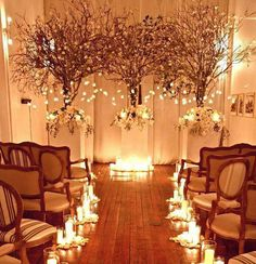 "Clusters of candles and ""snow"" by each row. Winter wonderland, floral wedding concept."