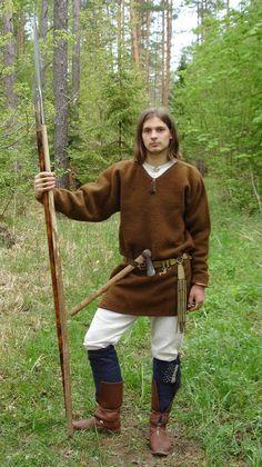 Wool overtunic, belt and footwear.