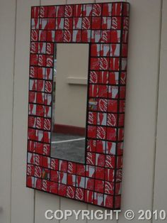 Framed mirror made out of recycled Coca-Cola cans by MetamorphosisKnysna @ Etsy