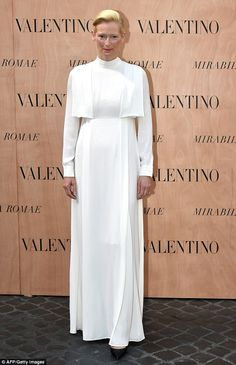 Statuesque: Tilda Swinton was also a front row star at the event and wowed in a striking h...