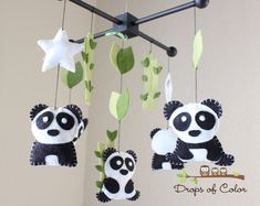 Baby Mobile - Baby Crib Mobile - Nursery Family Pandas Mobile - Panda Mobile - Bamboo Trees Mobile (You can pick your colors). $90.00, via Etsy.