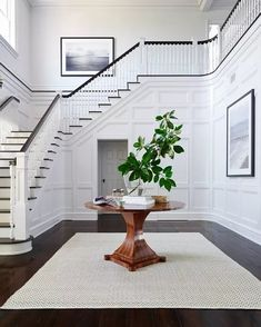 Foyer staircase ideas entry traditional with framed art framed art round wood table entry table Interior Stairs, Interior Architecture, Foyer Staircase, Staircases, Luxury Staircase, Entrance Foyer, Staircase Ideas, Decor Interior Design, Interior Decorating