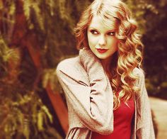 Taylor Swift, love her hair and love the red lipstick.