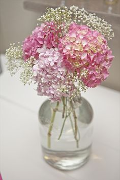 pink hydrangeas ( I would want to use blue or red and baby's breath in glass vase - Love!!
