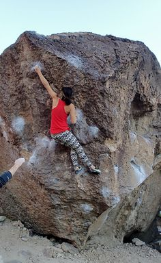 Jackie Trejo catching the tiny crimp at the crux of Carrot Top V3. happy boulders, bishop, ca.