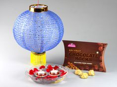 Monginis Food Pvt Ltd is the most trusted & biggest Cake brand in India since We are the largest manufacturers of Cakes, Pastries, packaged good and other baked products. Diwali Gift Hampers, Cake Branding, Chocolate Rocks, Red Stones, Diwali Gifts, Big Cakes, Cake Shop, Dried Fruit, Christmas Bulbs