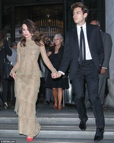 Glam and dapper: The couple captured much attention as they stepped out in their stunning ensembles