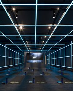 A jaw-dropping workout space built to coincide with Beijing's 2015 World Athletics Championship.Spearheaded by Shanghai-based design agency coordination Asia, the NIKE Studio is built to coincide … Gym Lighting, Linear Lighting, Lighting Design, Conduit Lighting, Club Design, Gym Design, Retail Design, Studio Design, Gym Interior