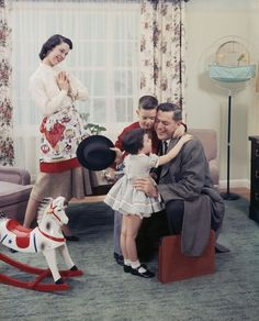 The 1950s nuclear family...Dad works, mom stays home with her two children-a boy and a girl- house is spotless when dad comes home and dinner on the table.