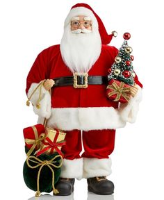 Santa dons his traditional red suit and comes bearing gifts this holiday season. The 24-inch Traditional Santa figurine from Holiday Lane is a classic addition to your holiday decor. | Polyester/plast