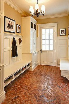 MUD ROOM:  Exposed brick floor is forgiving, rugged, and durable, yet classic.  Library and crown moldings are classic and beautiful.  Door and window let in natural light.  Shoe shelves are perfect height.  Cabinets hide most of the mess.  Perfect!