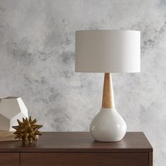 Featuring a white ceramic and wood base with a white linen shade, the simple styling of Wallin Table Lamp has a distinctly Nordic disposition. Embodying a brilliant blend of modern and chic charm, this table lamp will offer the ideal addition to your space. This perfect piece effortlessly will update your space, taking any décor to unmatchable levels of trend and sophistication. Maintaining faultless aspects of construction and fashioning a fusion of affordability and durable décor, this…