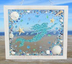 Unique beach window art by Luminosities! Teal mermaid made from broken glass pieces, surrounded by blue abalone shells, sea glass, starfish, sand dollars and shells. Sea Glass Crafts, Sea Crafts, Sea Glass Art, Stained Glass Art, Mosaic Glass, Mosaic Diy, Seashell Art, Seashell Crafts, Seashell Projects