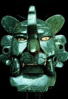 homoarchaeologicus:  Zapotec jade and shells mask, ca. 200 BC - 100 AD, Monte Alban, Mexico. Photography © Jorge Pérez de Lara.  Even though many scholars maintain that this is a bat mask, many of its features point towards its identification as a feline, possibly a jaguar. If this is correct, it may be associated with power and royal lineages. Regardless of its identification, it is one of the most valuable treasures ever recovered from Monte Albán. - mesoweb.com