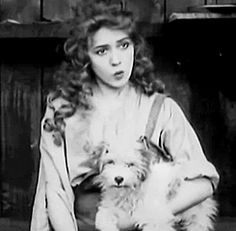 Mary Pickford and dog GIF - no Fairbanks or Pickford could ever resist a dog!