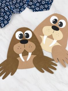 Looking for an easy handprint craft for preschool kids? This handprint walrus is super cute and easy to make when you us Animal Crafts For Kids, Winter Crafts For Kids, Winter Kids, Diy For Kids, Daycare Crafts, Preschool Activities, Fun Crafts, Artic Animals, Handprint Art