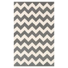 Bring a pop of pattern to your master suite ensemble or living room seating group with this hand-woven wool rug, showcasing a bold chevron motif in a neutral...