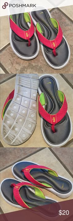 Nike flip flops size 7 Pink yellow and gray Nike flip flops gently used like new condition size 7 Nike Shoes Sandals