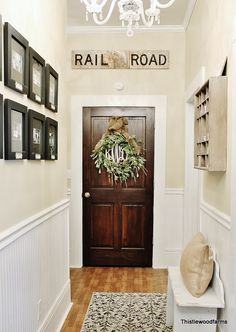 I love this hallway.  The paint is Sherwin Williams Ivoire.  ♥ the Railroad sign!