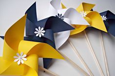 Paper Pinwheels in Nautical Colors. Wedding Decor. Navy Blue Yellow & White (set of 10). $32.00, via Etsy.