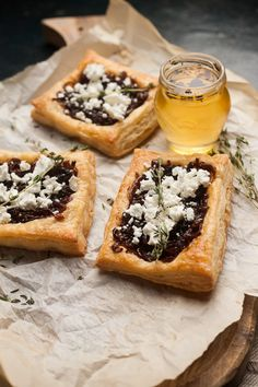 Caramelised onion and goat's cheese tart in a crisp puff pastry shell and drizzled with truffle honey.