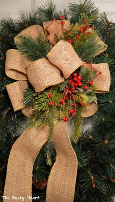 Decorated Burlap Bow. @jessika torres torres torres Sullivan, this is a pretty way to do the burlap bow, it would go well in one of your wreaths or even just on the wall or along your tv stand.