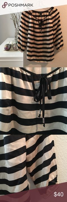 NWT WHBM silky striped tie-neck blouse NWT White House Black Market silky blouse with black and champagne stripes. Slightly shimmery/sateen look to the material. Tied at neck. Curved hem. Banded sleeve cuffs. White House Black Market Tops Blouses