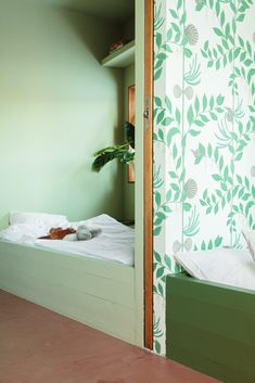 """Nine-year-old Herborg's ensuite bathroom (previously pictured) matches her bedroom, which is painted almost entirely in Cooking Apple Green by Farrow & Ball. The color was selected by Thurmann-Moe to complement the floral wallpaper—Secret Garden by Cole & Son—which was chosen by Herborg herself. """"She is so at one with her room, and it's so obvious that she is in her own space,"""" says Thurmann-Moe. #dwell #moderndesign #modernhometours #kidsroom Home Shelter, Create A Family, Cole And Son, Kid Spaces, Modern House Design, Design Projects, Home And Family, Sweet Home, Interior Design"""