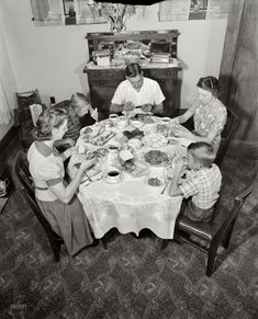 "Family Style: 1943 March 1943. Rochester, New York. ""The Babcocks at the dinner table."" Continuing the saga of war worker Howard Babcock and his family. Large-format negative by Ralph Amdursky for the Office of War Information."