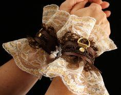 Leather & LACE Cuffs Steampunk Romantic Victorian sexy slave bracelets / bdsm cuffs, white lace, brass, brown leather. $70.00, via Etsy.