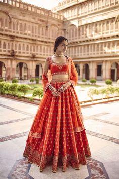 Looking for Red and orange simple bridal lehenga by Anita dongre? Browse of latest bridal photos, lehenga & jewelry designs, decor ideas, etc. Wedding Lehenga Designs, Designer Bridal Lehenga, Indian Bridal Lehenga, Indian Bridal Outfits, Indian Bridal Fashion, Indian Bridal Wear, Red Lehenga, Indian Fashion Dresses, Sabyasachi Lehenga Bridal