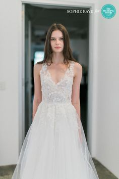 Christos sparkly embroidered wedding dress with tulle skirt // We're still dreaming of these refreshing New York Bridal Fashion Week finds from Alexandra Grecco, CHRISTOS BRIDAL, Leanne Marshall and Limor Rosen Bridal Couture! Like your favs, Wedding Scoopers! // : Sophie Kaye Photography for The Wedding Scoop