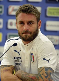 Daniele De Rossi Photos Photos - Daniele De Rossi of Italy during a press conference at Stadio Olimpico on August 13, 2013 in Rome, Italy. - Italy Press Conference