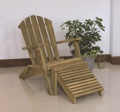 LuxCraft Wood Folding Adirondack Chair from DutchCrafters Amish Furniture. Enjoy sunrise and sunset anywhere from the comfort of this solid wood Adirondack chair that folds up easily. Made in Ohio of pressure treated kiln dried yellow pine. Some assembly required. #woodadirondackchairs #patio