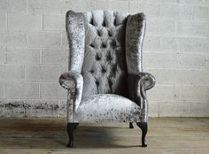 Based on a classic British Chesterfield wing chair with the iconic high back, the Audley Velvet Chesterfield Wing Chair combines a traditional shape with modern features, to give a modern design perfect for contemporary living. It features a soft comfortable cushioned seating base and classic deep buttoned high back, combined with modern sleek winged sides, offering pure comfort and ultimate style. - British handmade in our Manchester Factory - Premium sourced crushed velvet - Solid be...