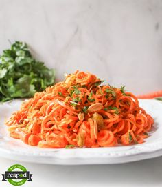 Spiralized Carrot Salad with Herbs and Toasted Almonds - Peas from the Pod - @DomesticateMe. Play with your food and #spiralize your carrots to make this yummy salad that's perfect for a side or  light lunch.