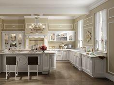Mobili eleganti per la cucina - Cucina all'americana arredata con mobili banchi dallo stile ricercato.