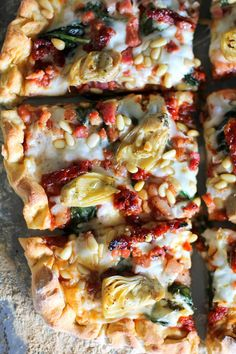 Prosciutto, Artichoke Heart, and Sun-Dried Tomato Pizza with Pine Nuts and Spinach   theroastedroot.net #glutenfree #pizza @bobsredmill @roastedroot