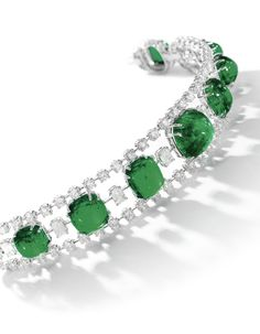 Emerald and diamond bracelet Designed as a graduated line of cabochon and sugarloaf emeralds and step-cut diamonds, between lines of brilliant-cut diamonds, length approximately Diamond Bracelets, Ankle Bracelets, Sterling Silver Bracelets, Bangles, Emerald Ring Vintage, Emerald Jewelry, Vintage Diamond, Modern Jewelry, Fine Jewelry