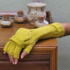Rockefeller Mitten Gloves By Tulle 29.99 at shopruche.com. These vibrant yellow gloves feature a soft knit and a fold-over mitten.  100% Acrylic