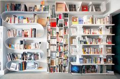 The shelves are awesome, and I love how the white showcases the colours of the books.