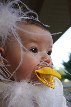 "@ Britt R- DH, ur ""fuzzy"" needs this:) Too funny!!! Chicken pacifier! Holy cuteness!!"