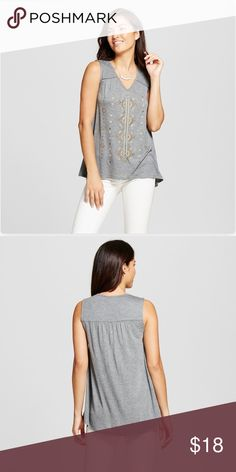 🆕 embellished Knit tank - gray This gray tank top is perfect for taking any simple ensemble to the next level - with living embellishments gracing the bodice.   Material: 100% rayon Length: below waist  Features: sleeveless, pullover Neckline: v neck Pattern: embroidered pattern Care and cleaning: machine wash and tumble dry   From a smoke and pet free home Knox Rose Tops Tank Tops
