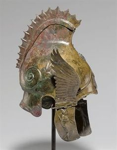 A GREEK BRONZE WINGED HELMET OF PHRYGIAN-CHALCIDIAN TYPE                                                                                                                                                                       LATE CLASSICAL PERIOD, CIRCA 4TH CENTURY B.C.