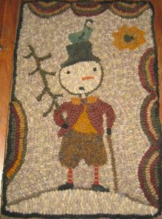 Such a charming little snowman rug!